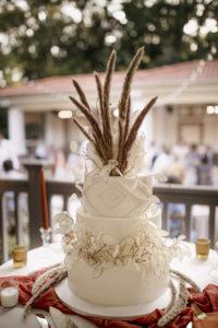 Three Tiered Round Wedding Cake with Intricate Natural Pampas Grass Detailing | Boho Wedding Cake Topper