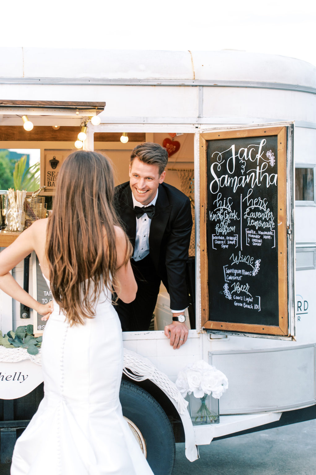 Groom Looking At Bride from Inside Mobile Bar Cart | Tampa Bay Wedding Photographer Kera Photography | Wedding Hair and Makeup Femme Akoi Beauty Studio
