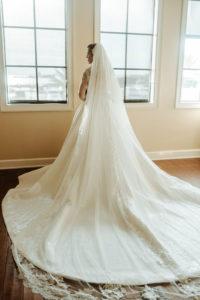 Florida Bride in Glamorous Full Skirt Train and Full Length Lace Veil