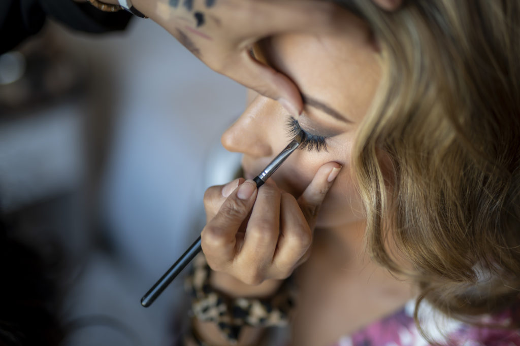 Florida Bride Getting Makeup Put on for Wedding   Tampa Bay Wedding Hair and Makeup Femme Akoi Beauty Studio