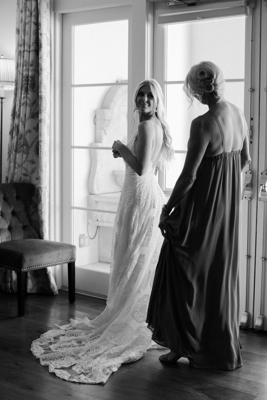 Black and White Photo of Bride in Lace Wedding Dress Getting Wedding Ready