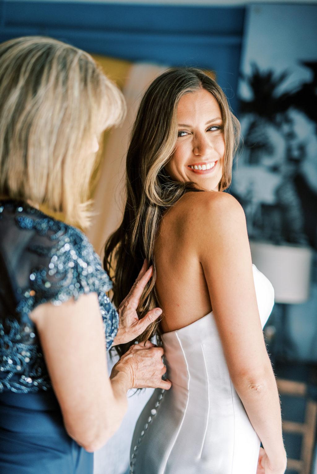Florida Bride with Mom Putting Wedding Dress On | Tampa Bay Wedding Photographer Kera Photography | Wedding Hair and Makeup Femme Akoi Beauty Studio
