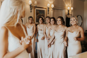Bride First Look with Bridesmaids in Matching Champagne Gold Silky Dresses