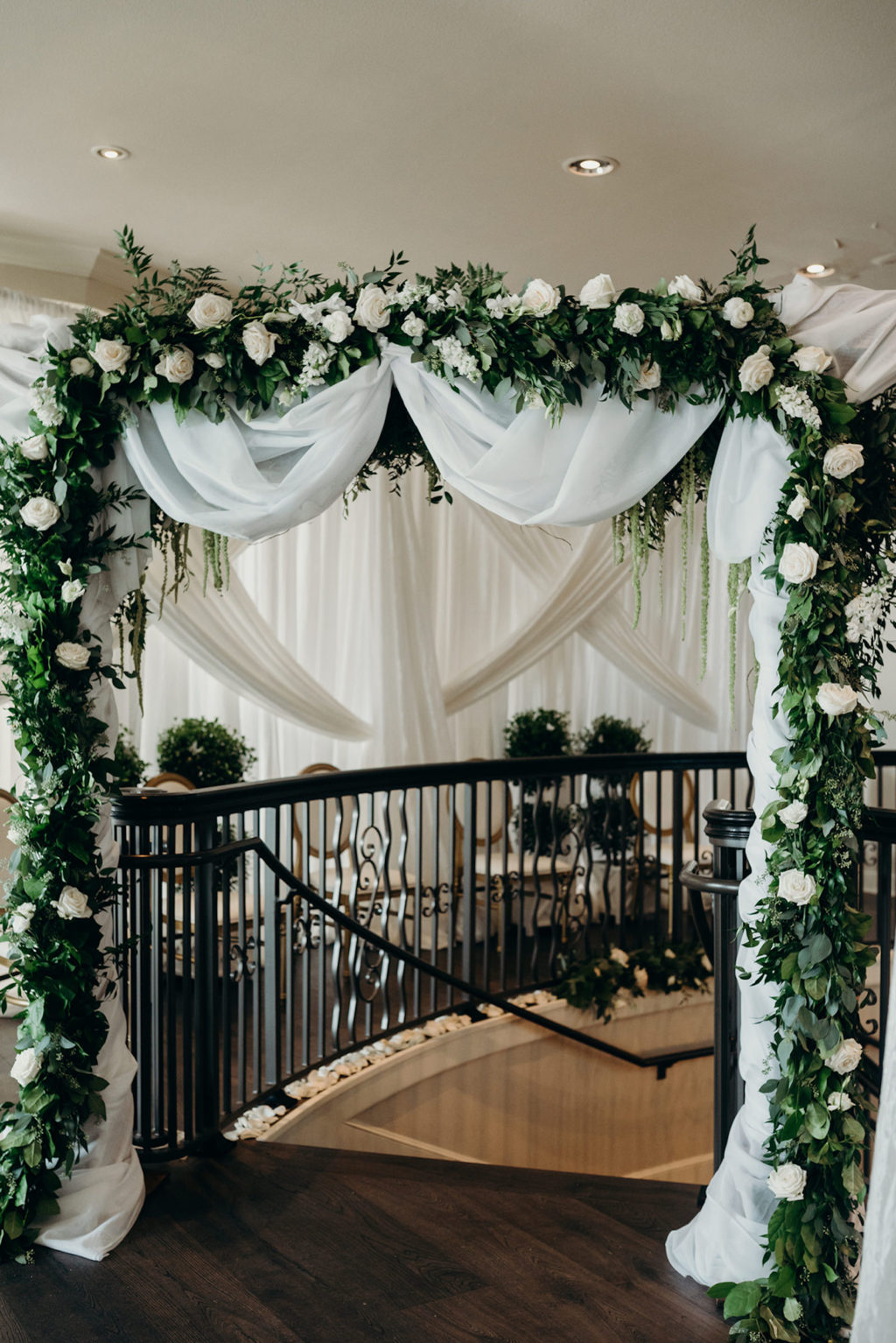 Elegant Timeless Wedding Ceremony Decor, Arch with White Linen Draping, Greenery Garland with White Roses on Top of Staircase   Tampa Bay Wedding Venue Westshore Yacht Club