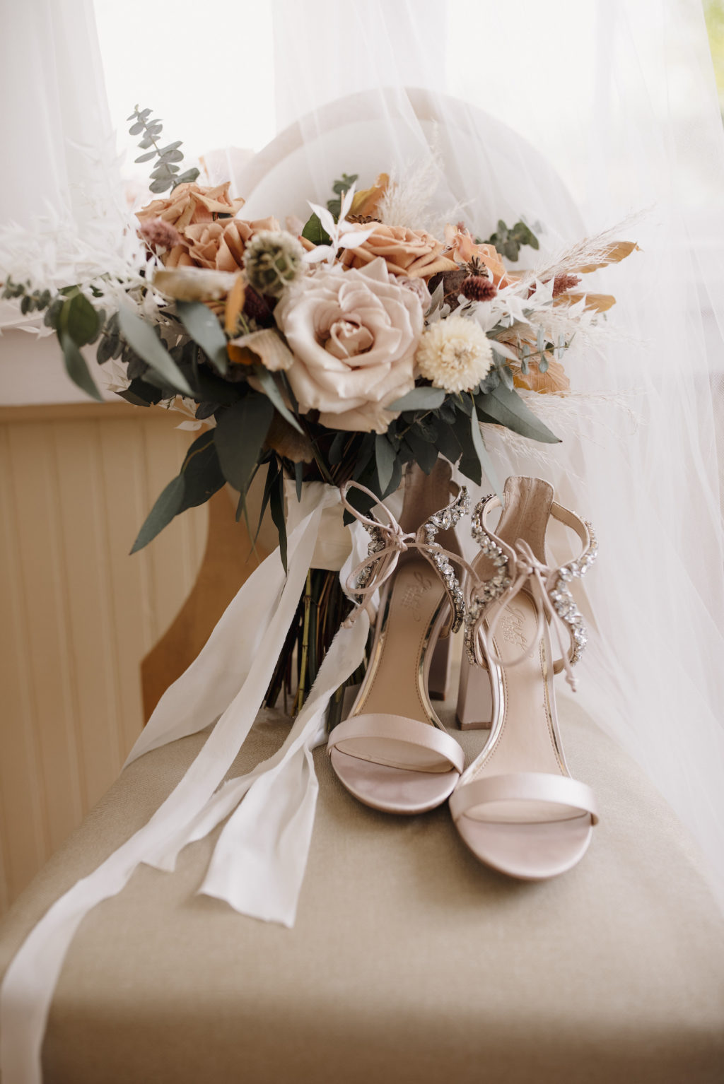Neutral Beige Roses and Orange Floral Boho Wedding Bouquet with Greenery   Open Toed Wedding Shoes with Laced Up Beading Detail