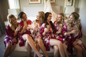 Florida Bride and Bridesmaids in Pink Silk Floral Robes | Tampa Bay Wedding Hair and Makeup Femme Akoi Beauty Studio