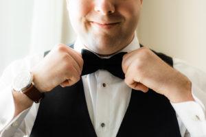 Tampa Groom Getting Wedding Ready Putting on Black Bowtie