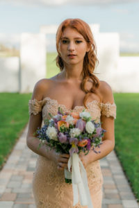 Vintage Bride in Off the Shoulder Fitted Lace Wedding Gown   Arden Bridal and Boutique Tampa   Pastel White, Purple, and Peach Floral Bouquet with Greenery