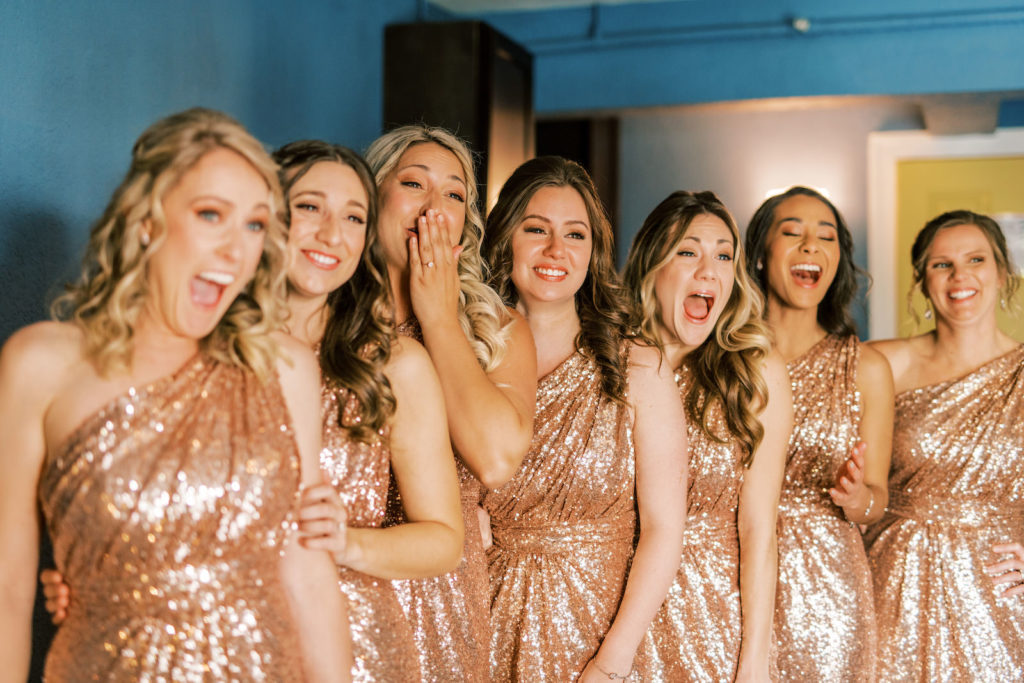 Bridesmaids in Matching Rose Gold Sequin One Shoulder Dresses Reaction to Bride in Wedding Dress | Tampa Bay Wedding Photographer Kera Photography | Wedding Hair and Makeup Femme Akoi Beauty Studio