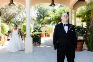 Bride and Groom First Look Wedding Photo, Groom Back to Bride Wearing Black Tuxedo