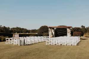 Outdoor Golf Course Wedding Ceremony Decor, Pergola, White Folding Chairs   Bradenton Wedding Venue The Concession Golf Club
