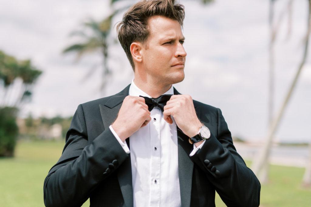 Florida Groom Adjusting Black Bowtie in Tuxedo | Tampa Bay Wedding Photographer Kera Photography