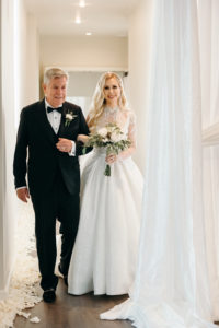 Classic Elegant Bride in Ballgown Wedding Dress with Long Sleeve Embellished Illusion Bodice Walking with Father Down the Wedding Ceremony