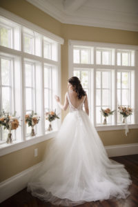 Low Back Lace Detail Ballgown Wedding Dress | Florida Bride in her Dress Before the Wedding Portrait | Paloma Blanca, Overskirt: Hayley Paige | Sarasota Wedding Photographer Alisa Sue Photography