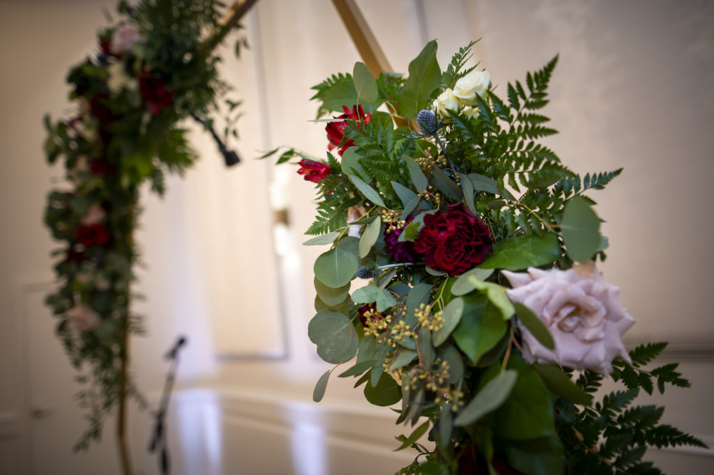 Wedding Ceremony Decor, Gold Round Arch with Greenery, Blush Pink and Burgundy Roses   Tampa Bay Wedding Planner Coastal Coordinating