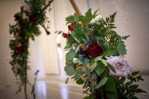 Wedding Ceremony Decor, Gold Round Arch with Greenery, Blush Pink and Burgundy Roses | Tampa Bay Wedding Planner Coastal Coordinating