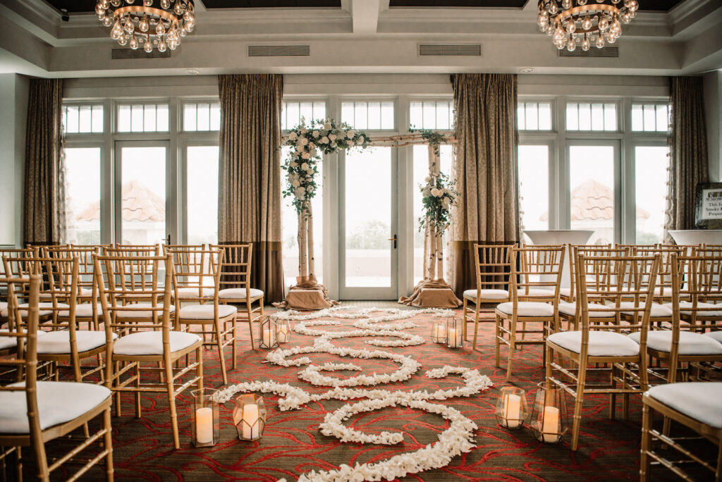 Romantic Indoor Ballroom Wedding Ceremony with Gold Chiavari Chairs | St. Pete Rental Company Gabro Event Services | Venue The Birchwood | Tampa Bay Planner Perfecting the Plan