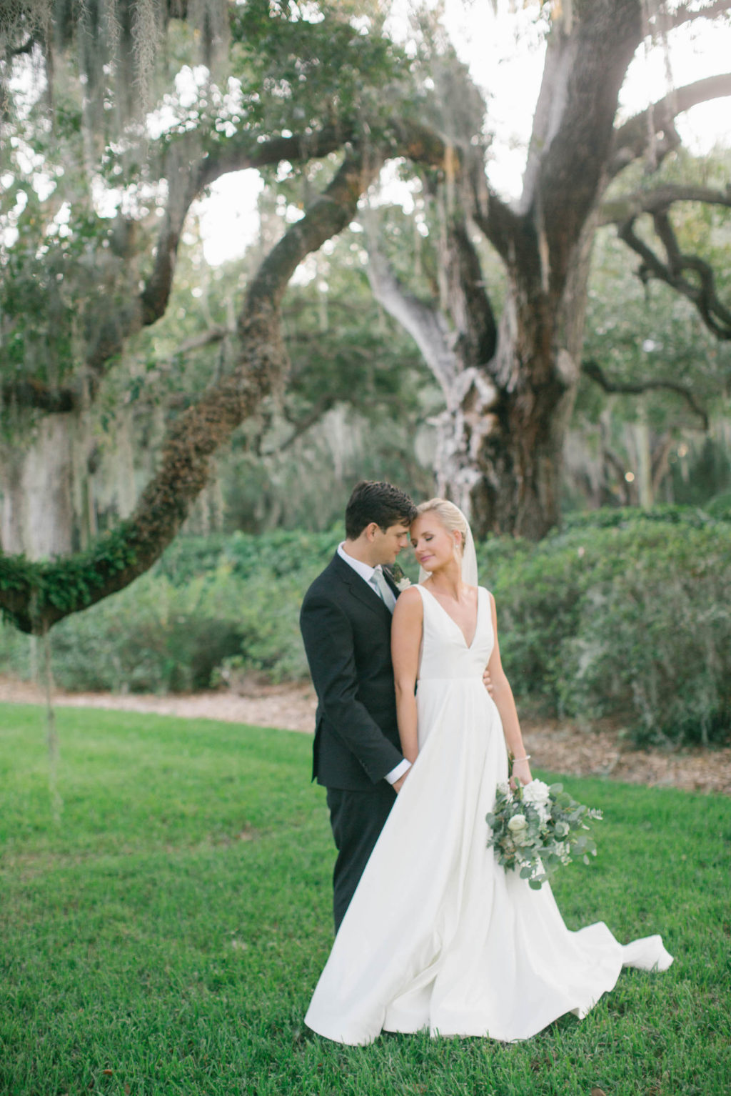 Bride and Groom Wedding Portrait | Bride in BHLDN Illusion Back Wedding Ballgown Dress with Classic Updo and Natural Makeup | South Tampa Hair and Makeup Artist Femme Akoi Beauty Studio