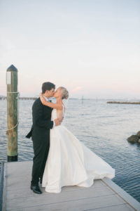 Bride and Groom Wedding Portrait   Bride in BHLDN Illusion Back Wedding Ballgown Dress with Classic Updo and Natural Makeup   South Tampa Hair and Makeup Artist Femme Akoi Beauty Studio
