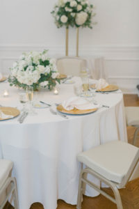 White Linen, Gold Chargers with White Napkins, White Rose and Greenery Centerpieces   Tampa Bay Wedding Florist FH Events