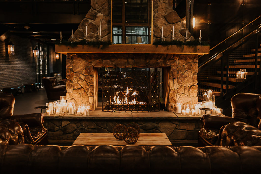Romantic and Intimate Tampa Bay Wedding Reception with Fireplace Backdrop and Candles | Venue Urban Stillhouse