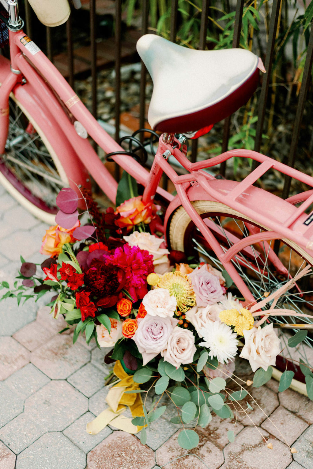 Colorful Pink Retro Bicycle with Floral Boutique, Lilac Roses, Yellow Pincushion Protea, Pink and Red Flowers, Red Eucalyptus, Green Eucalyptus   Tampa Bay Wedding Photographer Dewitt for Love