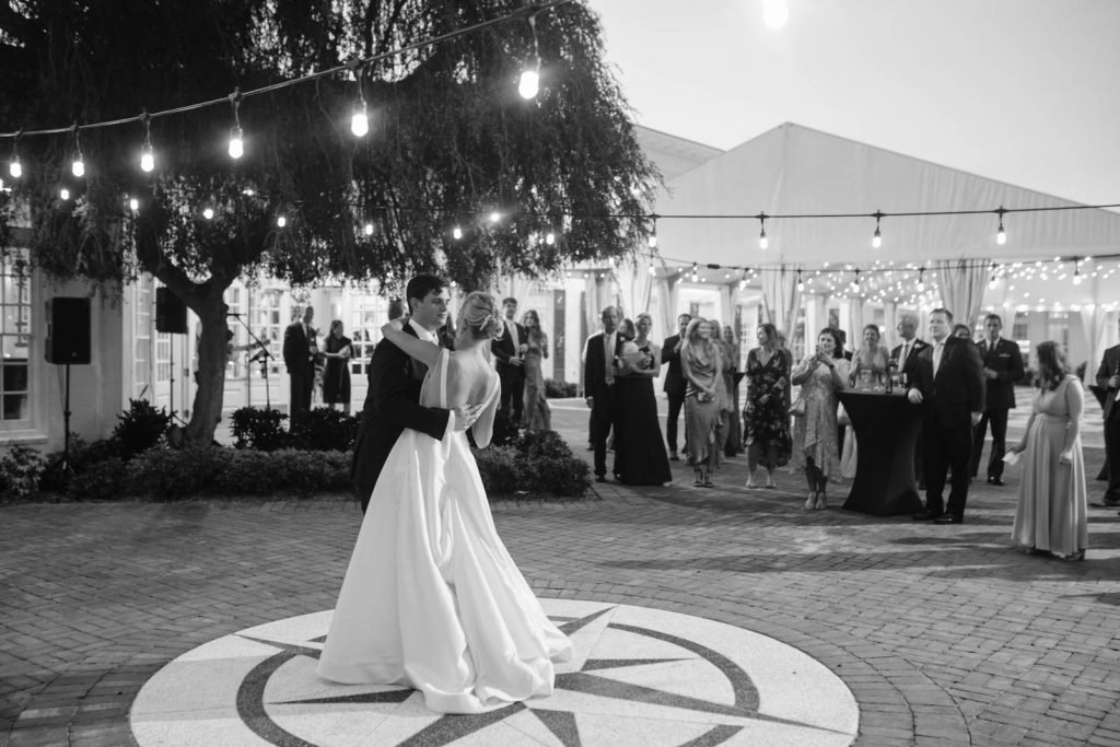Bride and Groom First Dance Outdoor Wedding Portrait | Bride in BHLDN Illusion Back Ballgown Wedding Dress with Classic Updo and Natural Makeup | Tampa Bay Hair and Makeup Artist Femme Akoi Beauty Studio | Reception Venue Tampa Yacht & Country Club
