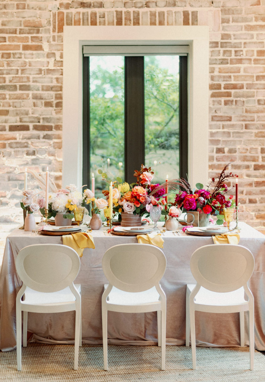 Whimsical and Colorful Wedding Reception Decor, White Dining Chairs, Yellow, Red and White Candlesticks, Colorful Flower Low Centerpieces   St. Pete Modern Industrial Wedding Venue Red Mesa Events   Tampa Wedding Photographer Dewitt for Love   Linen Rentals Kate Ryan Event Rentals