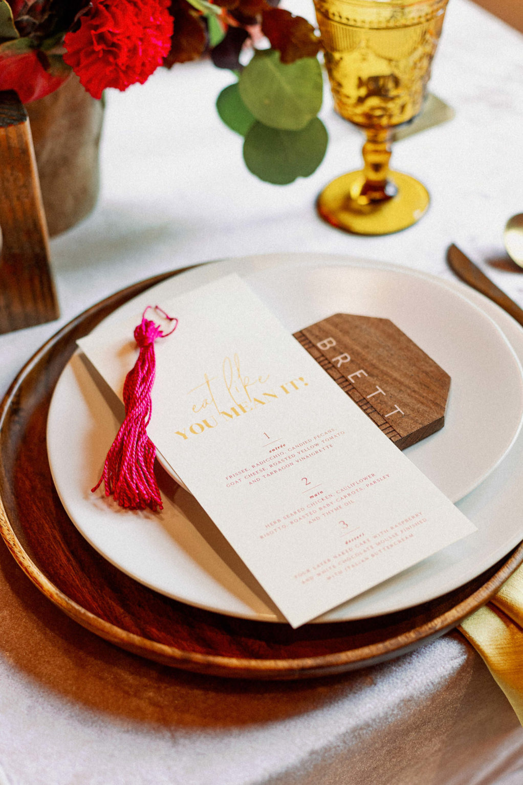 Whimsical and Colorful Wedding Reception Decor, Wooden Charger and Geometric Wood Shape Place Card, Hot Pink Fuschia Tassel, White and Gold Font Menu, Vintage Glassware   Tampa Bay Wedding Photographer Dewitt for Love   Linen Rentals Kate Ryan Event Rentals