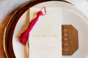 """Whimsical and Colorful Wedding Reception Decor, Wooden Charger, Geometric Wood Place Care, White and Gold Font """"Eat Like You Mean It"""" Menu, Hot Pink Fuschia Tassel 