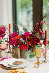 Whimsical and Colorful Wedding Reception Tablescape Decor, Fuschia and Pink, Red Low Floral Centerpiece, Eucalyptus, Tall Orange and Red Candlesticks, Yellow Vintage Glassware, Wooden Charger, Wood Geometric Shape Place Card | Tampa Bay Wedding Photographer Dewitt for Love | Linen Rentals Kate Ryan Event Rentals