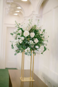 White Roses with Greenery Wedding Centerpieces   Gold Tall Floral Stand for Wedding Centerpieces   Tampa Wedding Florist FH Events