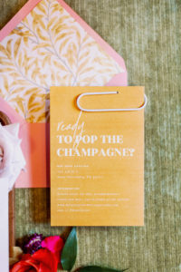 """Whimsical Colorful Pink Envelope with Floral Liner and Orange """"Ready to Pop the Champagne"""" Modern Wedding Invitation Suite 