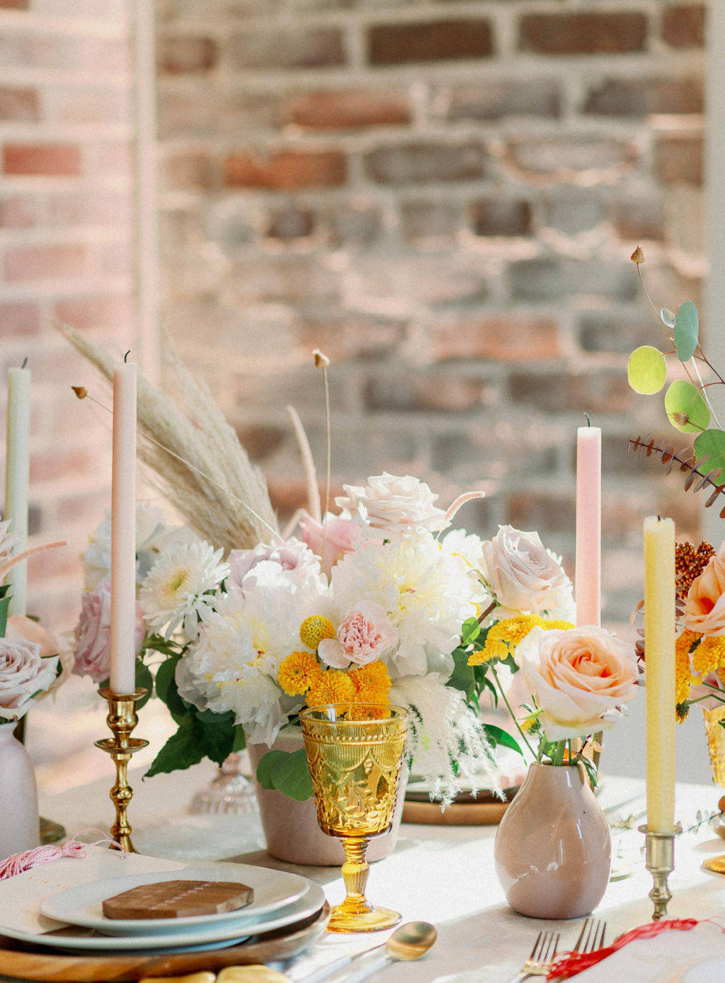 Whimsical Wedding Reception Decor, White Low Floral Centerpiece with Blush Pink Roses, Pampas Grass, Pink and Yellow Tall Candlesticks, Vintage Yellow Glassware   Tampa Bay Wedding Photographer Dewitt for Love   Linen Rentals Kate Ryan Event Rentals