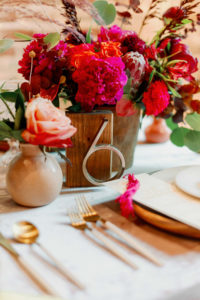 Whimsical and Colorful Wedding Reception Tablescape Decor, Fuschia Pink Flowers, Pink King Protea, Eucalyptus Low Floral Centerpiece, Wooden Table Number, Gold and White Flatware | Tampa Bay Wedding Photographer Dewitt for Love | Wedding Linen Rentals Kate Ryan Event Rentals