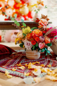 Whimsical and Colorful Wedding Reception Decor, Red Moroccan Style Rug, Blush Pink and Orange Roses, Yellow Pincushion Protea, Pink King Protea, Eucalyptus, Orange Flowers, Pink Anthurium, Yellow Rose Petals | Tampa Bay Wedding Photographer Dewitt for Love