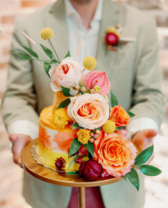 Whimsical and Colorful Yellow and Orange Small Two Tier Wedding Cake with Real Blush Pink and Orange Roses, Yellow Billy Ball Flowers | Tampa Bay Wedding Photographer Dewitt for Love
