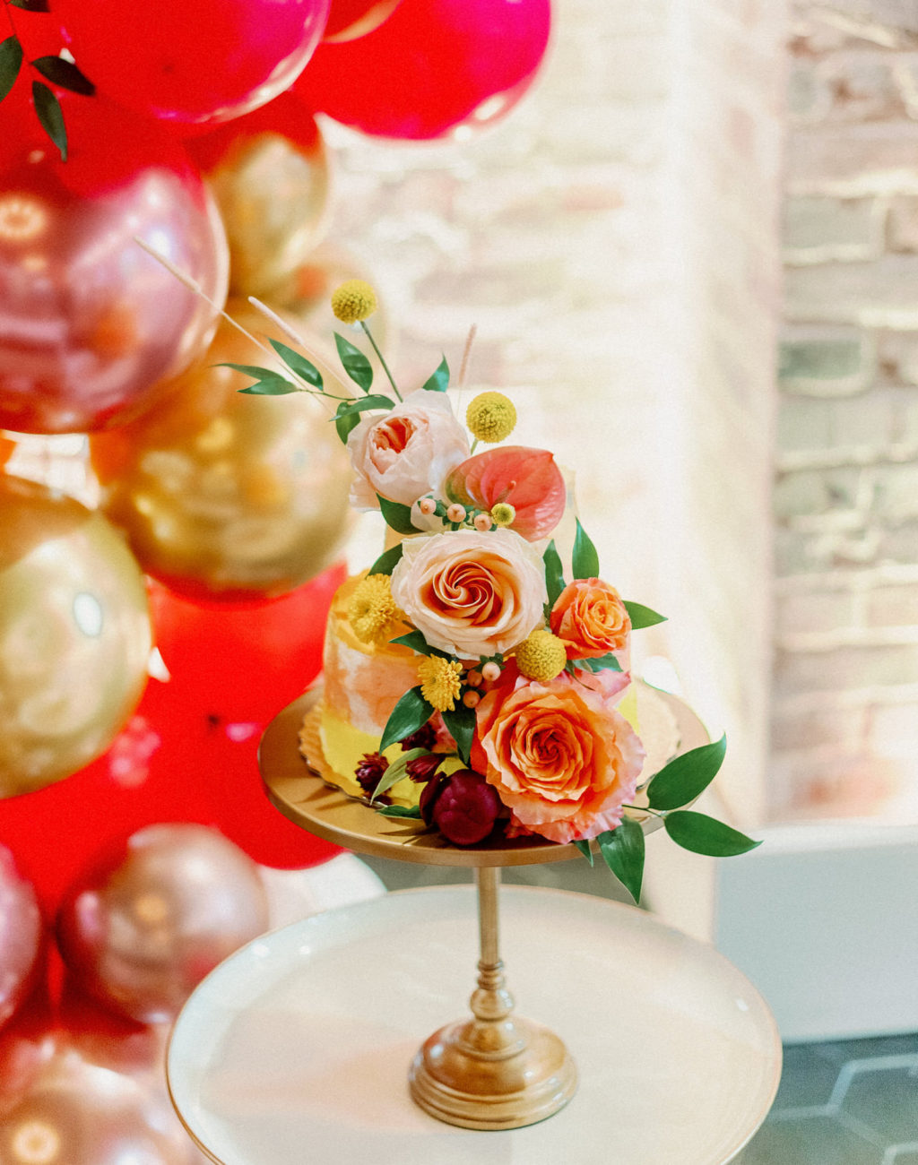 Whimsical and Colorful Yellow and Orange Small Two Tier Wedding Cake with Real Blush Pink and Orange Roses, Yellow Billy Ball Flowers   Tampa Bay Wedding Photographer Dewitt for Love