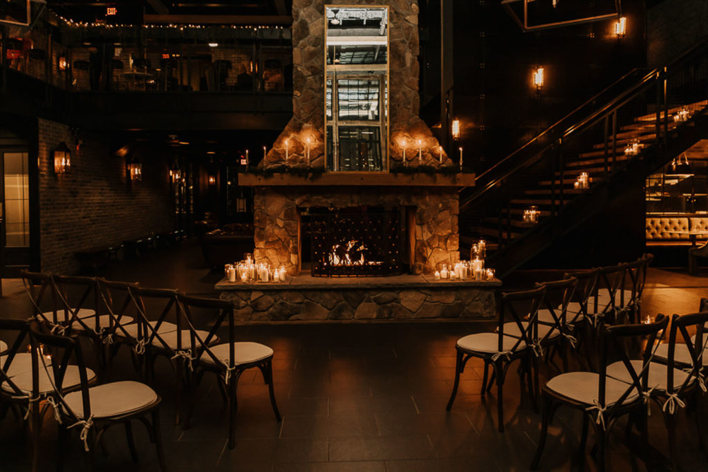 Dark and Moody Romantic and Intimate Tampa Wedding Ceremony with Cozy Fireplace and Candles | Downtown St. Pete Wedding Venue Urban Stillhouse