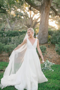 Elegant BHLDN White Wedding Dress with Long Train and Veil   Classic Updo with Simple and Natural Makeup   Tampa Hair and Makeup Artist Femme Akoi Beauty Studio