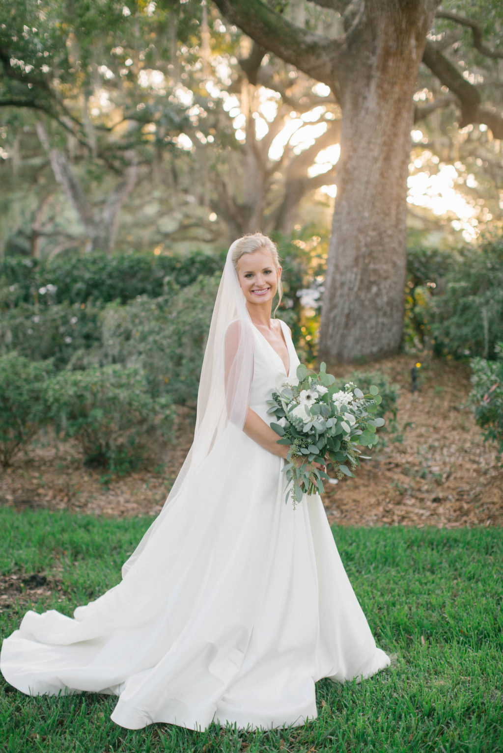 Elegant BHLDN White Wedding Dress with Long Train and Veil | Classic Updo with Simple and Natural Makeup | Tampa Hair and Makeup Artist Femme Akoi Beauty Studio