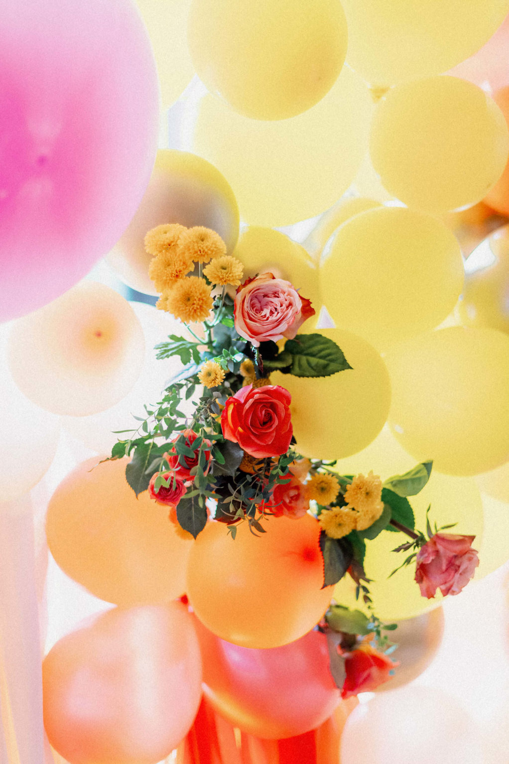Colorful and Whimsical Wedding Decor, Yellow, Pink, Orange and White Balloon Ceremony Backdrop with Yellow Marigolds and Orange and Pink Roses Floral Arrangement   Tampa Bay Wedding Photographer Dewitt for Love