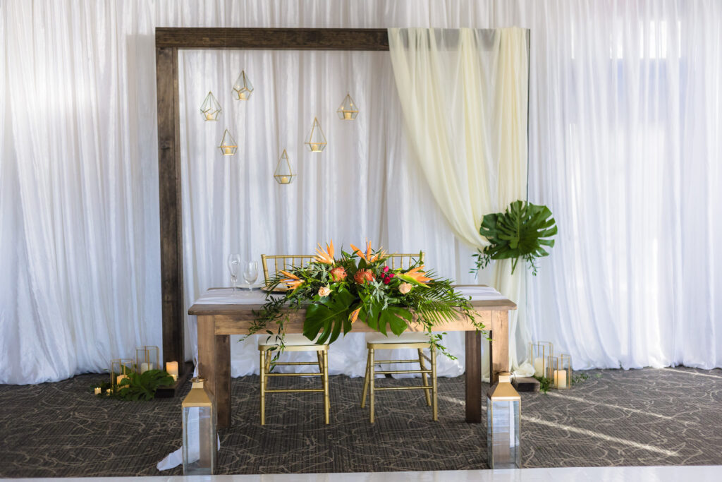 Rustic Tropical Wedding Reception with Draped Wall and Wooden Geometric Sweetheart Table Arch | Tampa Wedding Venue The Godfrey Hotel